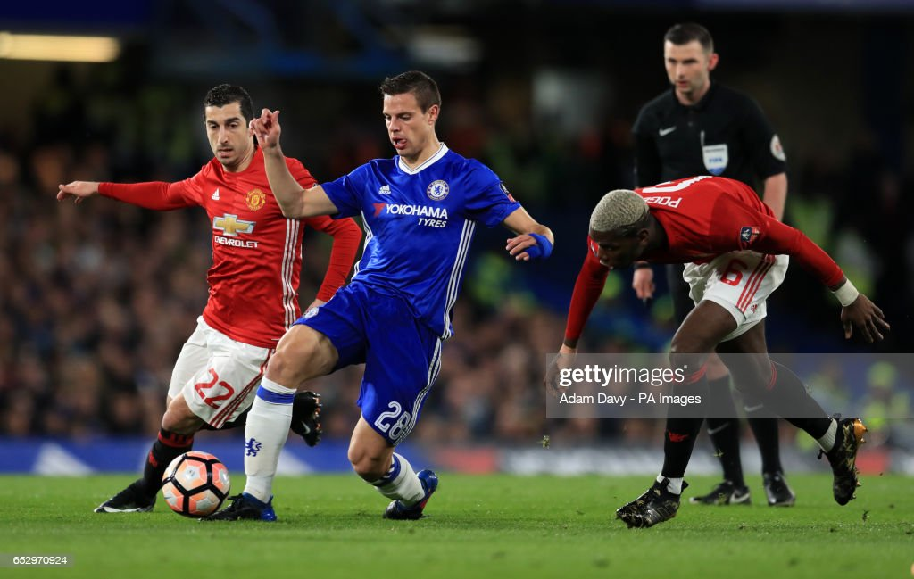 Manchester United's Henrikh Mkhitaryan, Chelsea's Cesar Azpilicueta and Manchester United's Paul Pogba during the Emirates FA Cup, Quarter Final match at Stamford Bridge, London.
