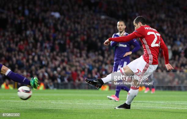 Manchester United's Henrikh Mkhitaryan scores his side's first goal of the game during the UEFA Europa League Quarter Final match at Old Trafford...