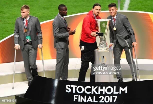 Manchester United's injured English defender Luke Shaw Manchester United's suspended Ivorian defender Eric Bailly Manchester United's injured Swedish...