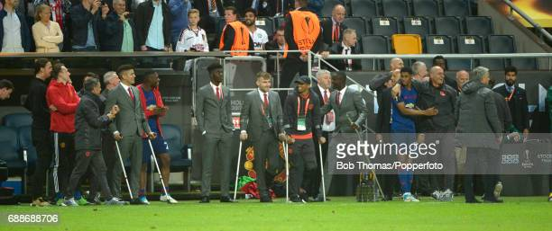 Manchester United's injured players using crutches for support including Luke Shaw Zlatan Ibrahimovic and Marcos Rojo watch the closing minutes of...