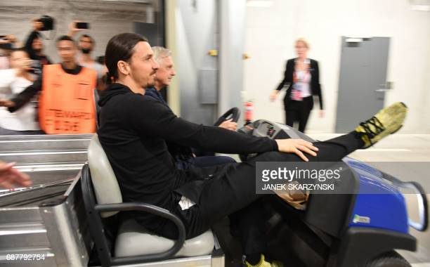 Manchester United's injured Swedish striker Zlatan Ibrahimovic arrives to watch the UEFA Europa League final football match Ajax Amsterdam v...