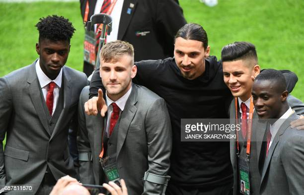 Manchester United's injured Swedish striker Zlatan Ibrahimovic poses with Manchester United's suspended Ivorian defender Eric Bailly Manchester...
