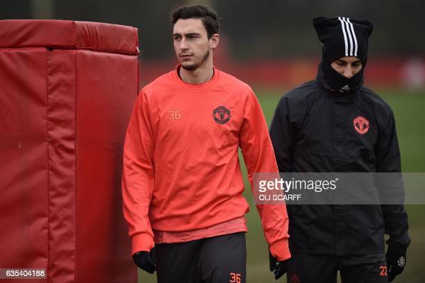 Manchester United's Italian defender Matteo Darmian and Manchester United's Armenian midfielder Henrikh Mkhitaryan attend a training session at their...