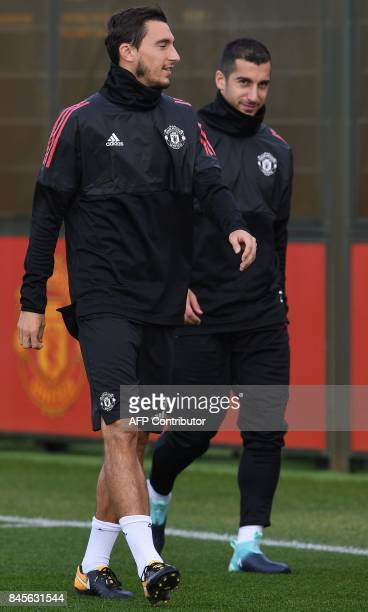 Manchester United's Italian defender Matteo Darmian and Manchester United's Armenian midfielder Henrikh Mkhitaryan attends a team training session at...