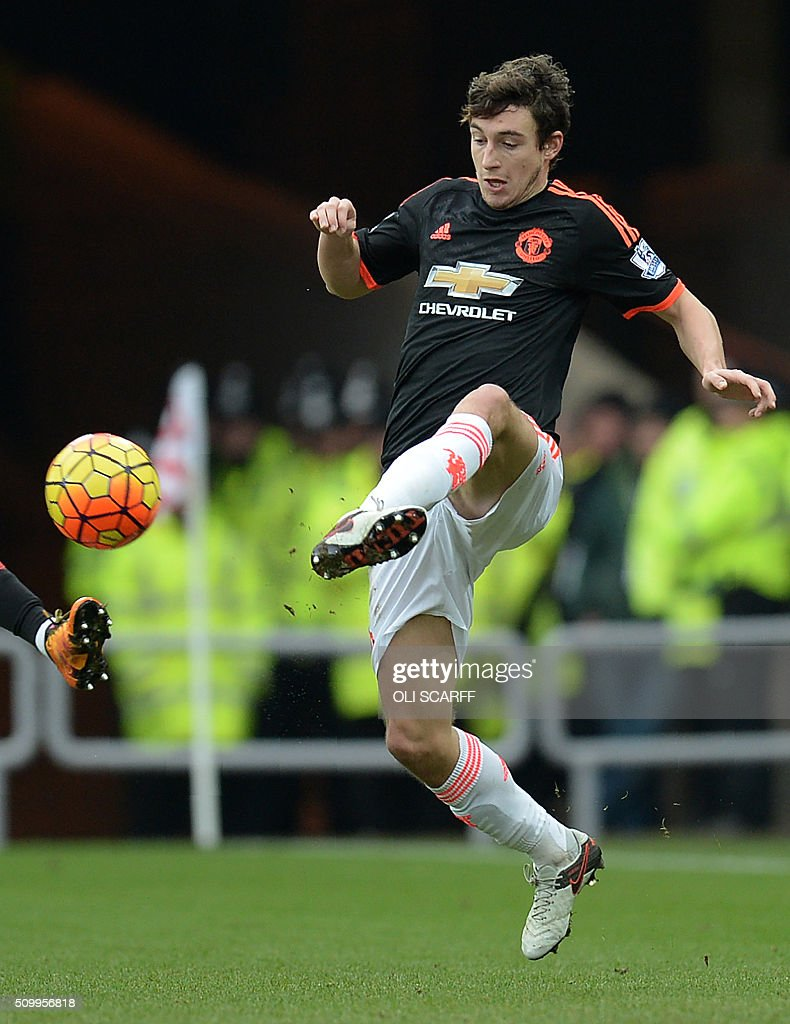Manchester United's Italian defender Matteo Darmian controls the ball during the English Premier League football match between Sunderland and Manchester United at the Stadium of Light in Sunderland, northeast England on February 13, 2016. / AFP / OLI SCARFF / RESTRICTED TO EDITORIAL USE. No use with unauthorized audio, video, data, fixture lists, club/league logos or 'live' services. Online in-match use limited to 75 images, no video emulation. No use in betting, games or single club/league/player publications. /