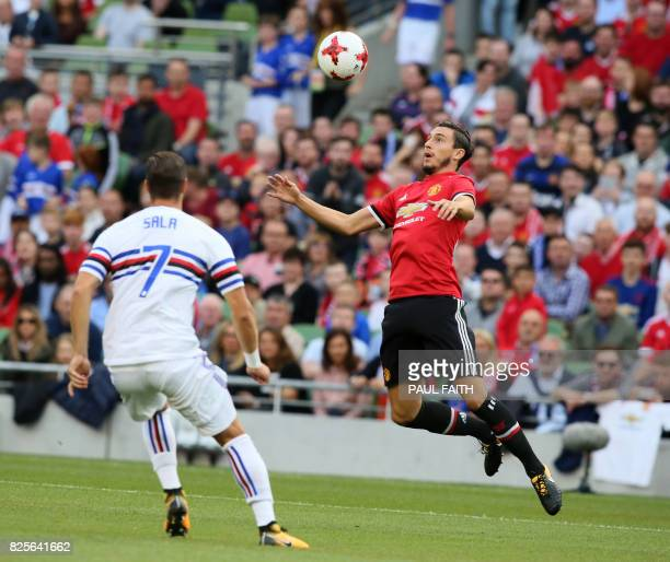 Manchester United's Italian defender Matteo Darmian vies with Sampdoria's Jacopo Sala during the preseason friendly game between Manchester United...