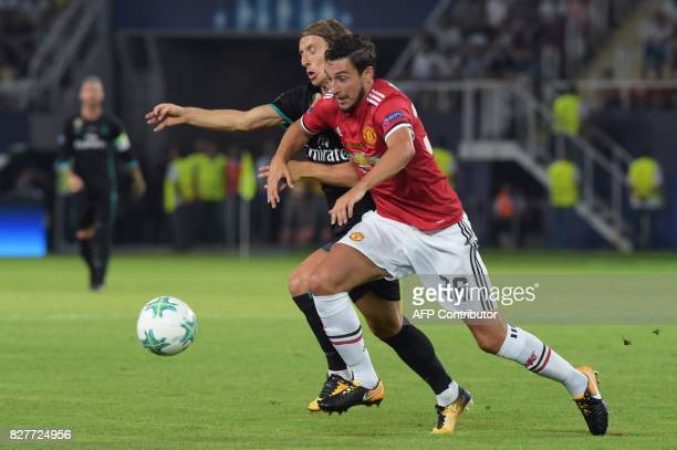 Manchester United's Italian defender Matteo Darmian vies with Real Madrid's Croatian midfielder Luka Modric during the UEFA Super Cup football match...