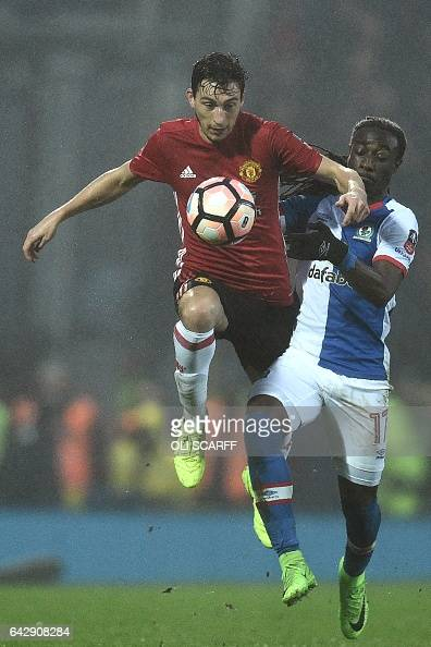 Manchester United's Italian defender Matteo Darmian vies with Blackburn Rovers' Dutch striker Marvin Emnes during the English FA Cup fifth round...