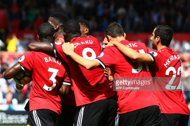 Manchester United's Ivorian defender Eric Bailly celebrates with teammates scoring the team's first goal during the English Premier League football...