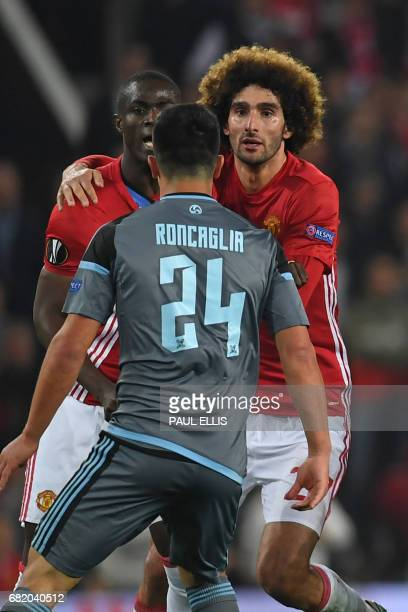 Manchester United's Ivorian defender Eric Bailly clashes with Celta Vigo's Argentinian defender Facundo Roncaglia as Manchester United's Belgian...