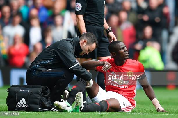 Manchester United's Ivorian defender Eric Bailly gets attention on the pitch for an injury during the English Premier League football match between...