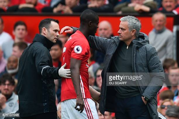 Manchester United's Ivorian defender Eric Bailly is greeted by Manchester United's Portuguese manager Jose Mourinho after being substituted with an...