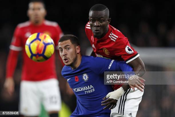 Manchester United's Ivorian defender Eric Bailly vies with Chelsea's Belgian midfielder Eden Hazard during the English Premier League football match...