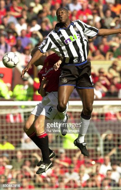 LEAGUE Manchester United's Jaap Stam left loses the aerial battle with Newcastle United's Carl Cort during the FA Carling Premiership match between...