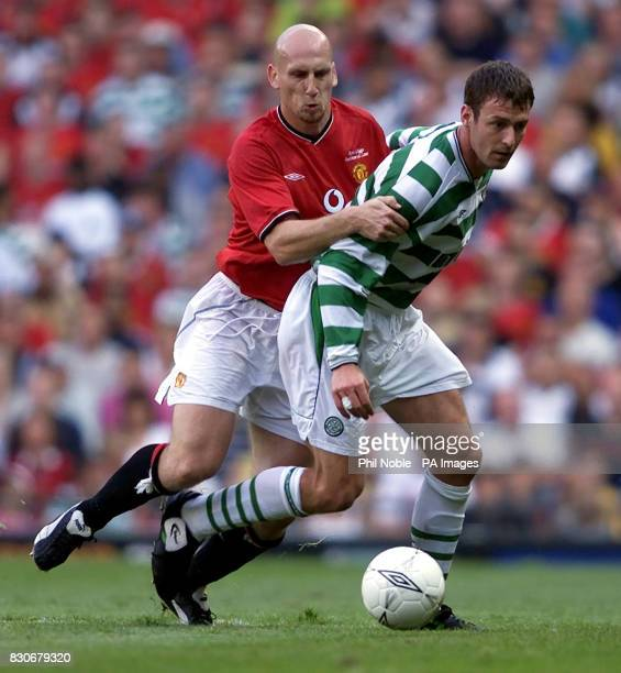 LEAGUE Manchester United's Jaap Stam tussles for the ball with Celtic's Chris Sutton during the Ryan Giggs Testimonial game at Old Trafford Manchester