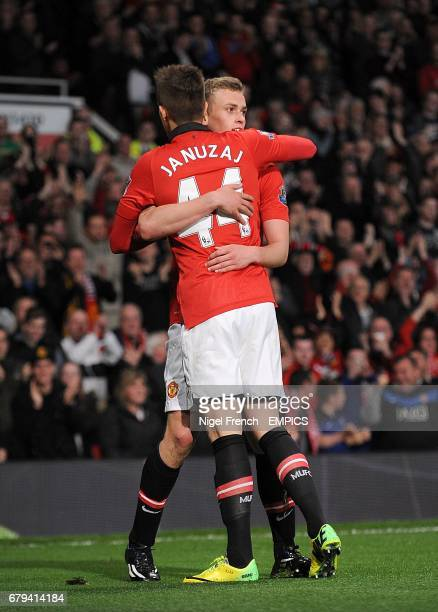 Manchester United's James Wilson celebrates with teammate Adnan Januzaj after scoring his team's second goal