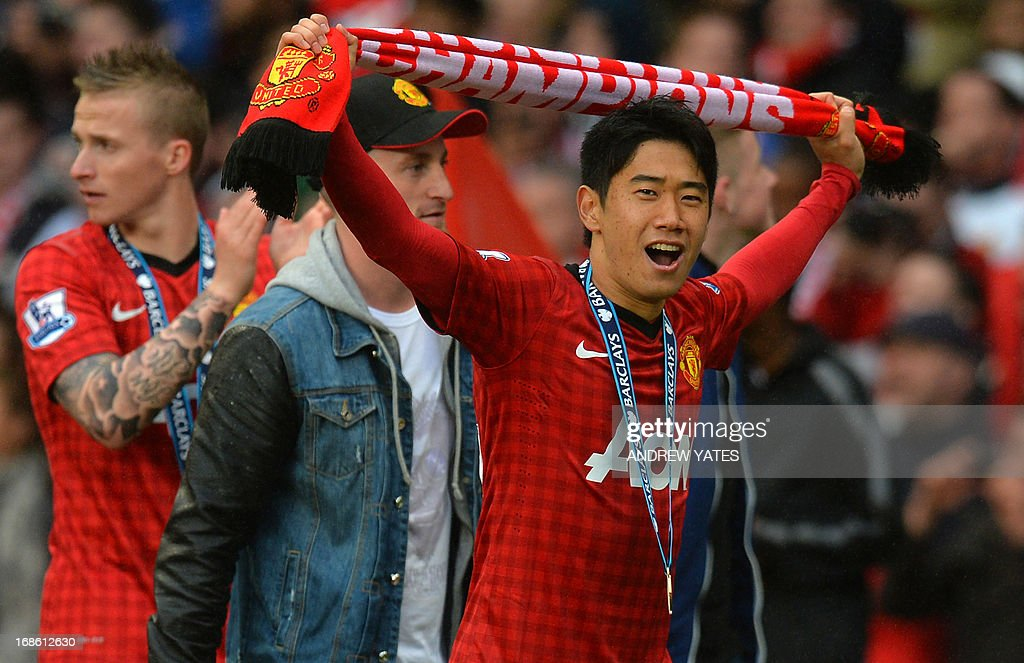Manchester United's Japanese midfielder Shinji Kagawa celebrates after receiving his Premier League championship winners' medal at the end of the English Premier League football match between Manchester United and Swansea City at Old Trafford in Manchester, northwest England, on May 12, 2013. USE. No use with unauthorized audio, video, data, fixture lists, club/league logos or live services. Online in-match use limited to 45 images, no video emulation. No use in betting, games or single club/league/player publications