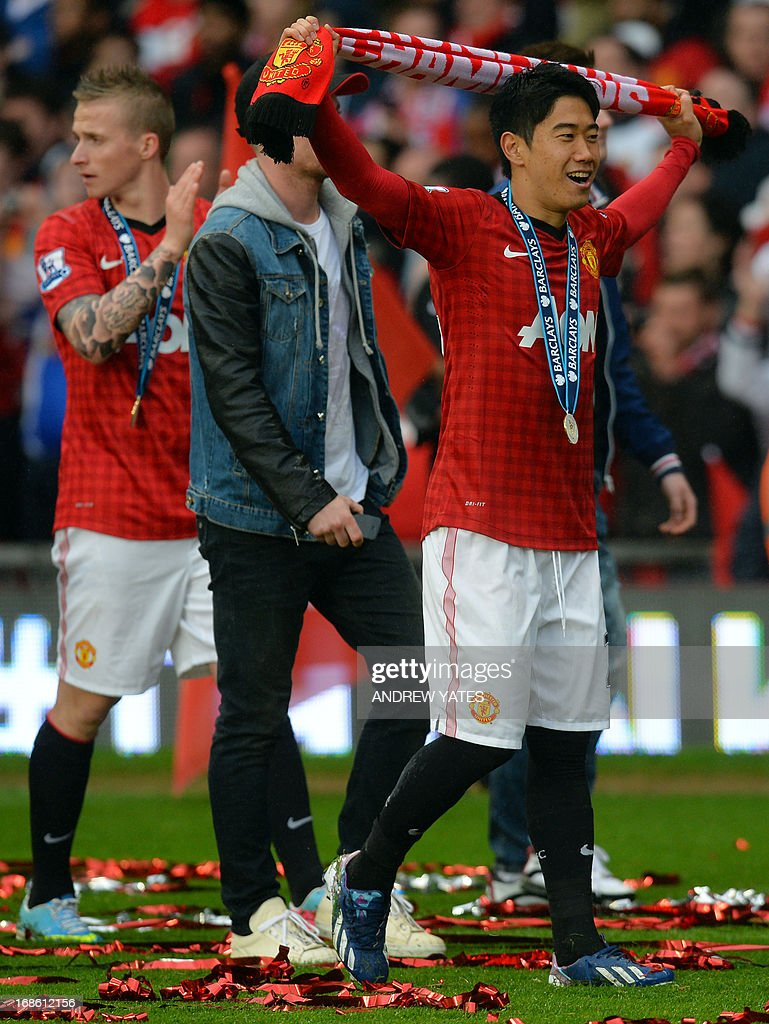 """Manchester United's Japanese midfielder Shinji Kagawa celebrates on the field after medal presentations for the Premier League champions at the end of the English Premier League football match between Manchester United and Swansea City at Old Trafford in Manchester, northwest England, on May 12, 2013. USE. No use with unauthorized audio, video, data, fixture lists, club/league logos or """"live"""" services. Online in-match use limited to 45 images, no video emulation. No use in betting, games or single club/league/player publications"""