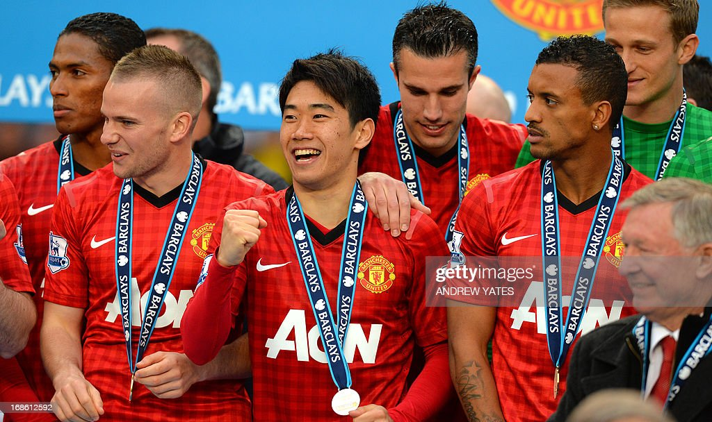 """Manchester United's Japanese midfielder Shinji Kagawa (C) celebrates on the podium at the end of the English Premier League football match between Manchester United and Swansea City at Old Trafford in Manchester, northwest England, on May 12, 2013. USE. No use with unauthorized audio, video, data, fixture lists, club/league logos or """"live"""" services. Online in-match use limited to 45 images, no video emulation. No use in betting, games or single club/league/player publications"""