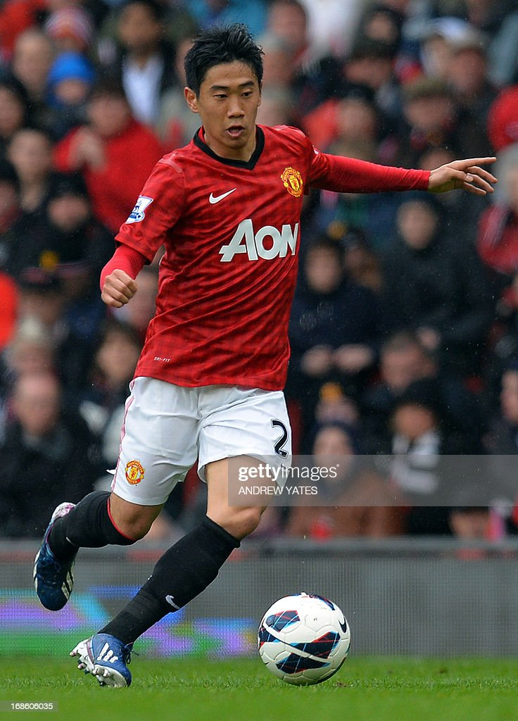 "Manchester United's Japanese midfielder Shinji Kagawa runs with the ball during the English Premier League football match between Manchester United and Swansea City at Old Trafford in Manchester, northwest England, on May 12, 2013. AFP PHOTO / ANDREW YATES USE. No use with unauthorized audio, video, data, fixture lists, club/league logos or ""live"" services. Online in-match use limited to 45 images, no video emulation. No use in betting, games or single club/league/player publications"