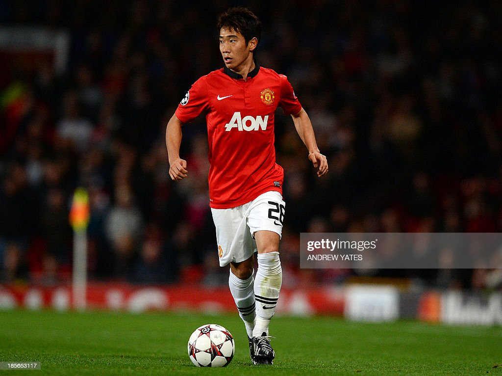 Manchester United's Japanese midfielder Shinji Kagawa runs with the ball during the UEFA Champions League football match between Manchester United and Real Sociedad at Old Trafford in Manchester, north west England on October 23, 2013.