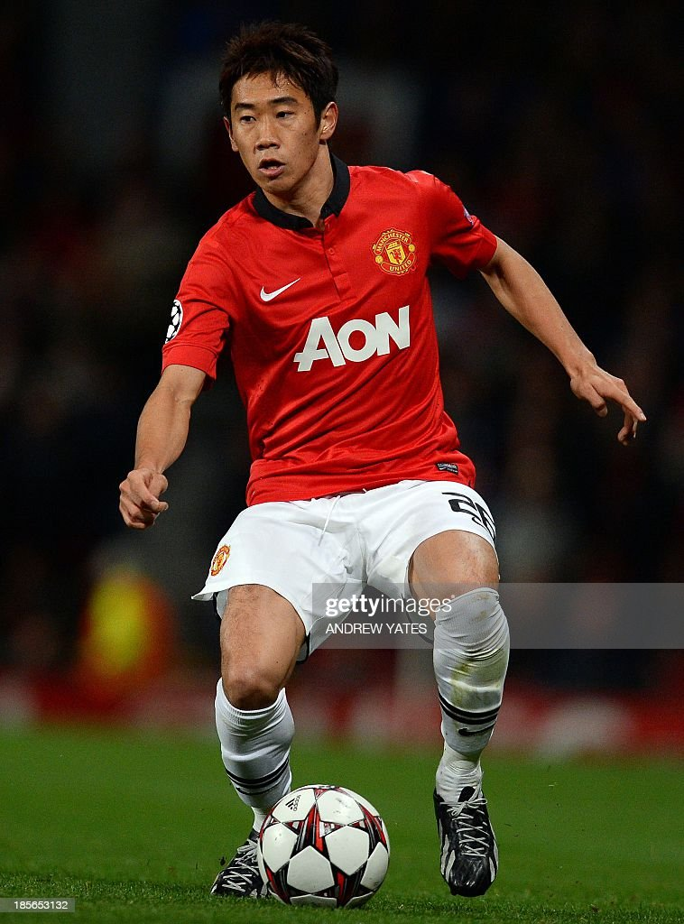 Manchester United's Japanese midfielder Shinji Kagawa runs with the ball during the UEFA Champions League football match between Manchester United and Real Sociedad at Old Trafford in Manchester, north west England on October 23, 2013. AFP PHOTO/ANDREW YATES