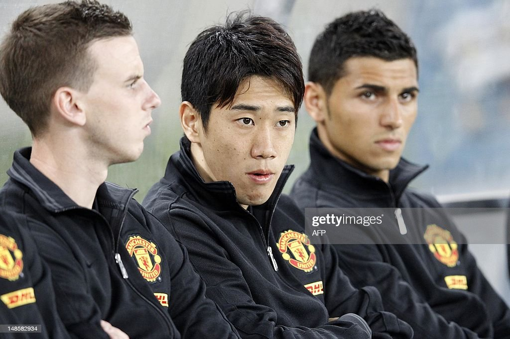 Manchester United's Japanese player Shinji Kagawa (C) looks on from the bench ahead of their MTN Football Invitational match against Amazulu at the Moses-Mabhida Stadium on July 18, 2012 in Durban.