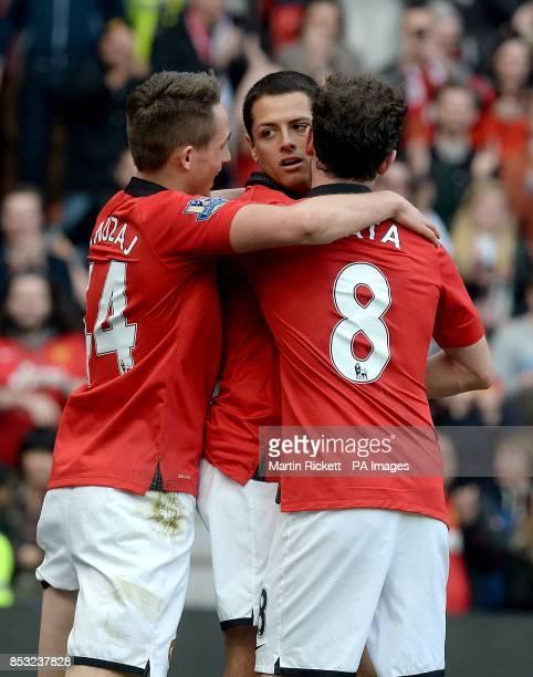 Manchester United's Javier Hernandez celebrates scoring his teams fourth goal of the game alongside teammates Juan Mata and Adnan Januzaj