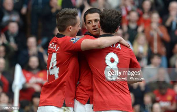 Manchester United's Javier Hernandez celebrates scoring his teams fourth goal against Aston Villa with Adnan Januzaj and Juan Mata during the...