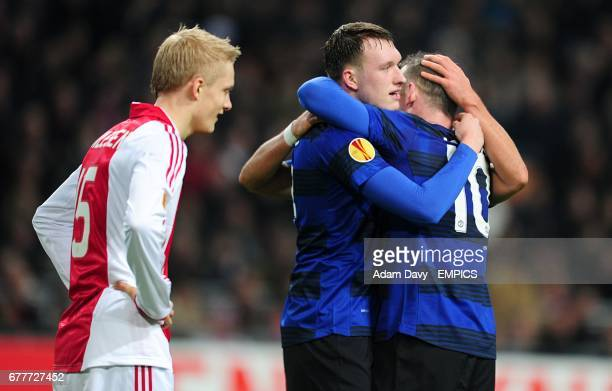 Manchester United's Javier Hernandez celebrates scoring their second goal of the game with teammates Wayne Rooney and Phil Jones as Ajax's Nicolai...