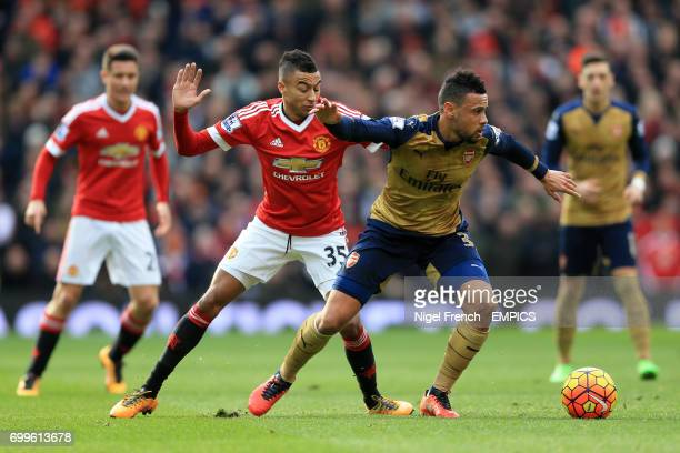Manchester United's Jesse Lingard and Arsenal's Francis Coquelin battle for the ball