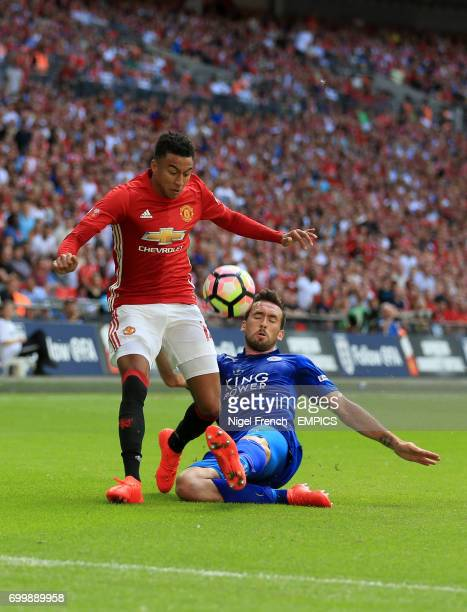 Manchester United's Jesse Lingard and Leicester City's Christian Fuchs battle for the ball