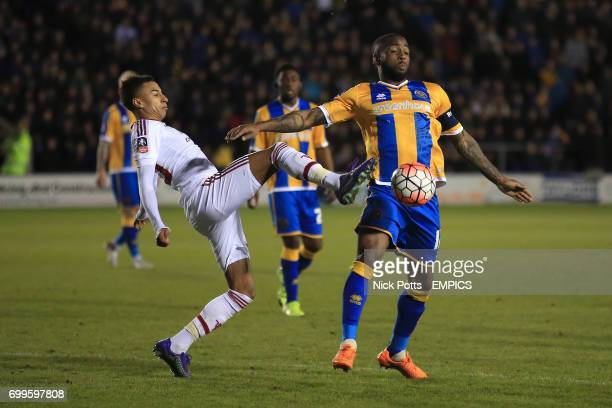 Manchester United's Jesse Lingard and Shrewsbury Town's Abu Ogogo battle for the ball
