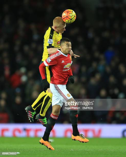Manchester United's Jesse Lingard and Watford's Ben Watson battle for the ball