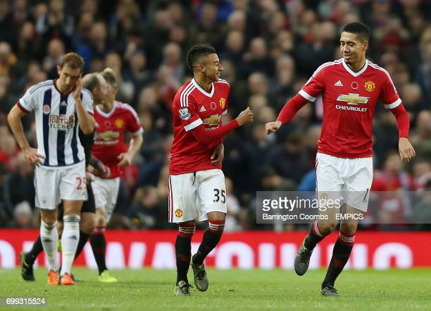 Manchester United's Jesse Lingard celebrates scoring against West Bromwich Albion with team mate Chris Smalling