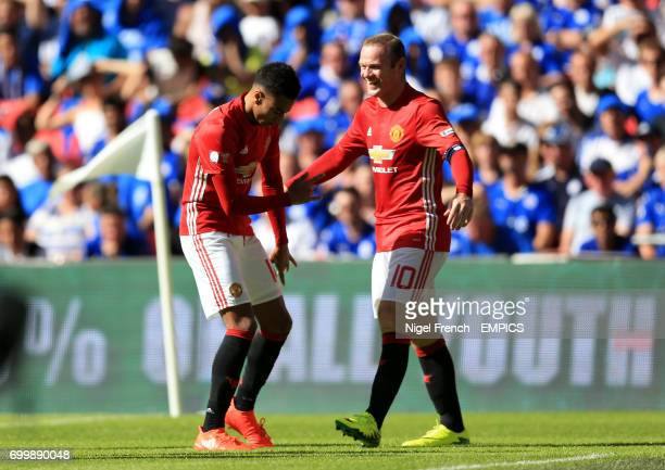 Manchester United's Jesse Lingard celebrates scoring his side's first goal of the game with team mate Wayne Rooney