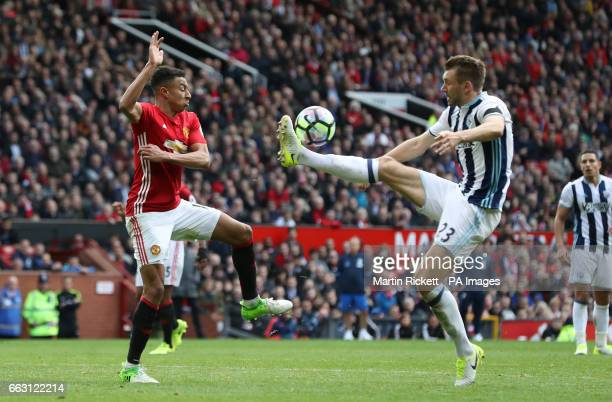Manchester United's Jesse Lingard in action with West Bromwich Albion's Gareth McAuley during the Premier League match at Old Trafford Manchester