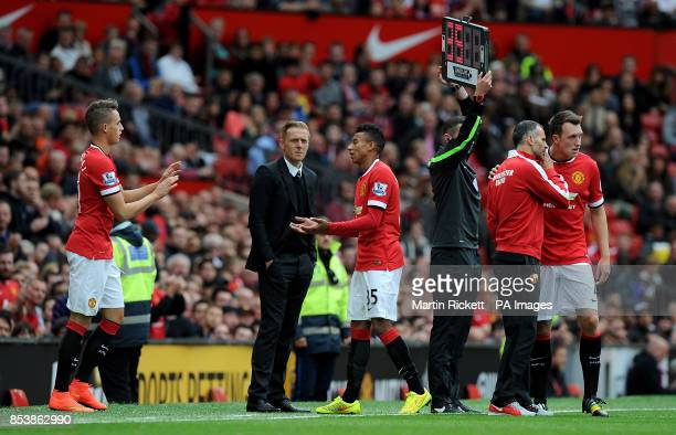 Manchester United's Jesse Lingard is replaced by Adnan Januzaj after an injury against Swansea City during the Barclays Premier League match at Old...