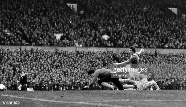 Manchester United's Joe Jordan bursts between the Nottingham Forest goalkeeper Peter Shilton and defender Larry Lloyd to steer the ball home for his...