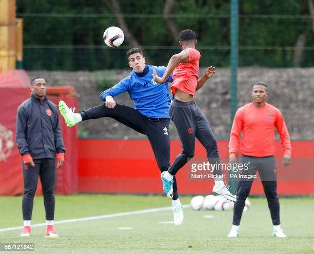Manchester United's Joel Pereira and Marcus Rashford during the training session at the AON Training Complex in Carrington ahead of the Europa League...