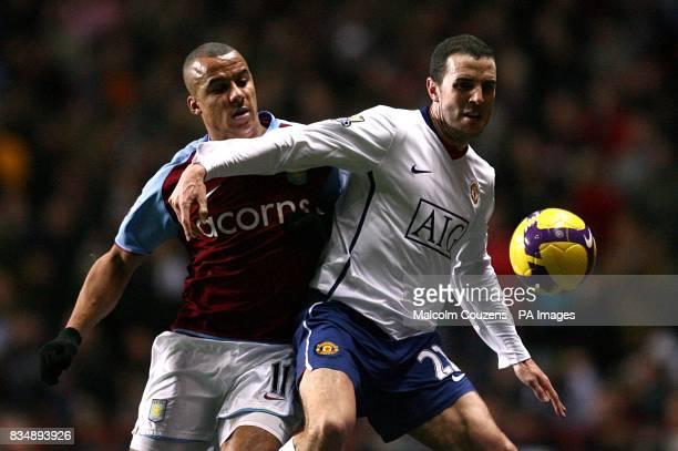 Manchester United's John O'Shea and Aston Villa's Gabriel Agbonlahor battle for the ball