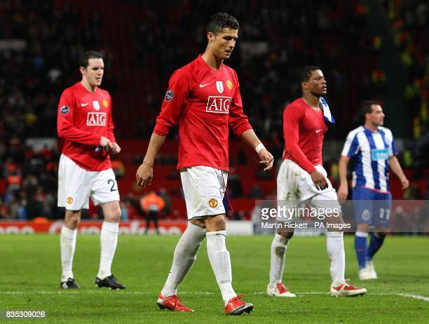Manchester United's John O'Shea Cristiano Ronaldo and Patrice Evra walk off dejected after the final whistle