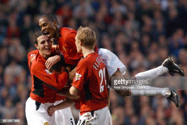 Manchester United's John O'Shea Quinton Fortune and Darren Fletcher congratulate Roy Keane on scoring their third goal