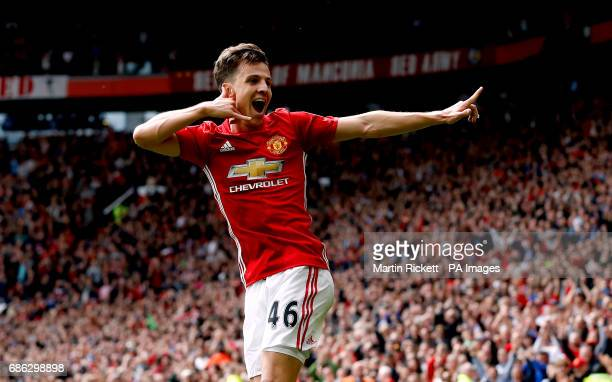 Manchester United's Josh Harrop celebrates scoring his side's first goal of the game during the Premier League match at Old Trafford Manchester
