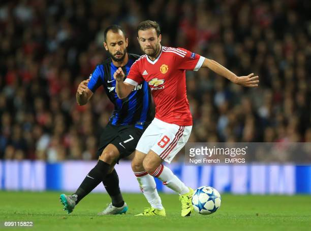 Manchester United's Juan Mata and Club Brugge's Victor Vazquez battle for the ball