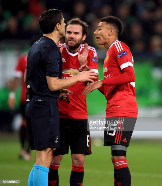 Manchester United's Juan Mata and Jesse Lingard appeal to the referee Milorad Mazic after he disallows a goal