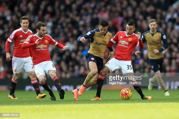 Manchester United's Juan Mata and Jesse Lingard battle for the ball with Arsenal's Alexis Sanchez