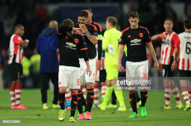 Manchester United's Juan Mata and Matteo Darmian dejected after the match