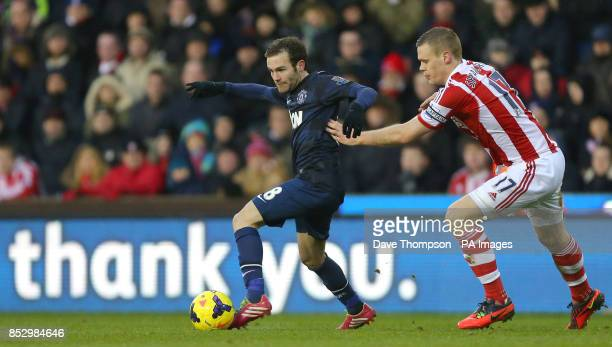 Manchester United's Juan Mata gets away from Stoke City's Ryan Shawcross during the Barclays Premier League match at the Britannia Stadium Stoke