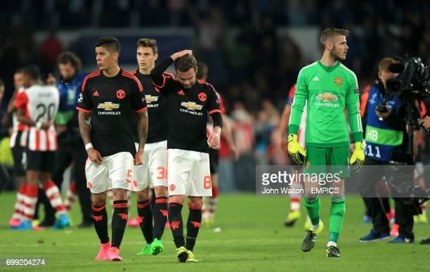 Manchester United's Juan Mata Marcos Rojo and David De Gea dejected after the match